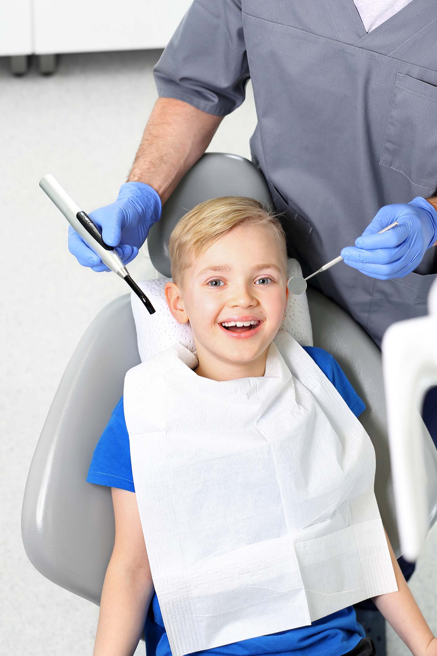 A child in a dental chair during a dental treatment